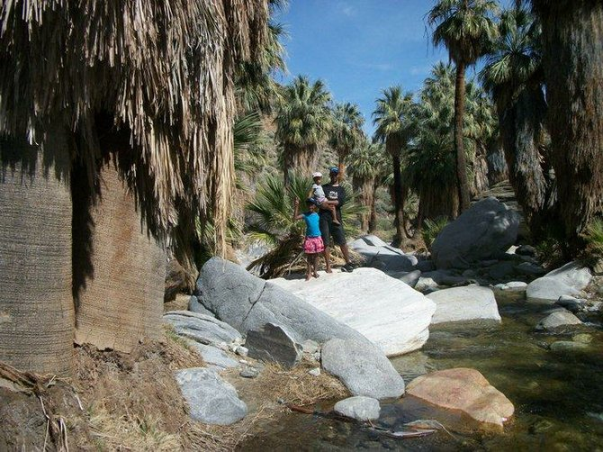 I took this picture of my family at the Indian Canyons oasis in Palm Springs. The river, the huge rocks and the shade provided by tall palm trees make it a very peaceful place.