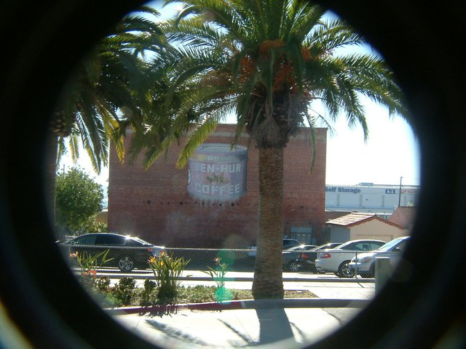 This is an from-across-the-street shot of the old Ben Hur ad on the side of a building.