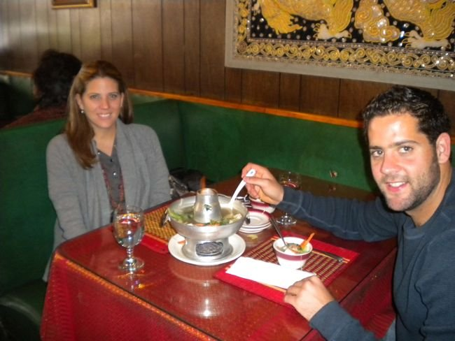 Karla and Oscar share a tofu soup hotpot.