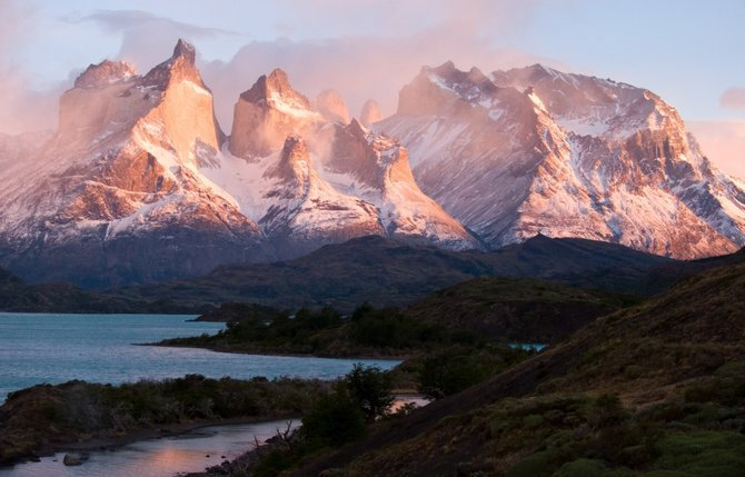 Sunrise sets a spectacular massif afire in Torres del Paine. Sparkling lakes – each a different hue of blue – dot the Chilean national park and frame the alpine peaks that are the namesake of this amazing corner of the world.
