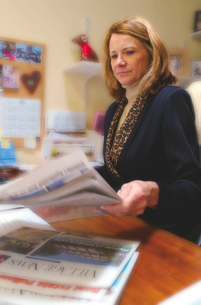 Julie Hoisington, owner of San Diego Community Newspaper Group, believes a competitor, Anthony Allegretti, is trying to shake her down.
