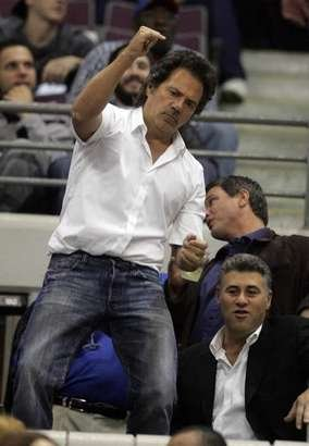"U-T owner Tom Gores dances ""almost John Travolta-like"" at a Detroit Pistons game. He recently bought the team."