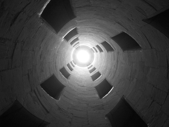 Looking up a spiral staircase in a castle on a trip to France.