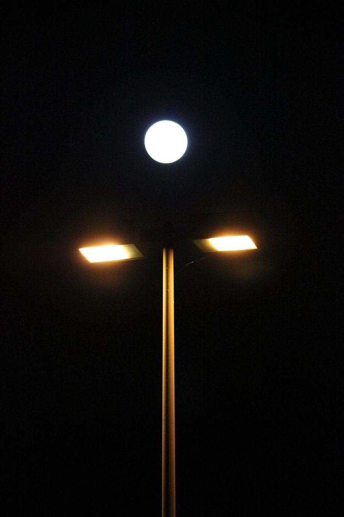 Street lights and a full moon.