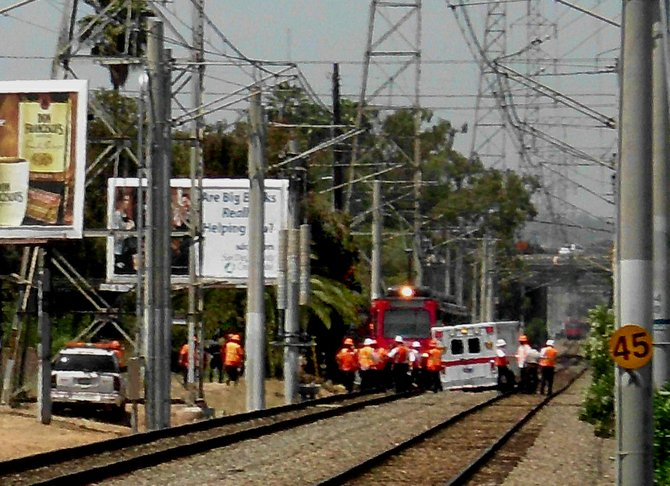 Police and paramedics swarmed the scene after a Caltrans worker was struck by a trolley.