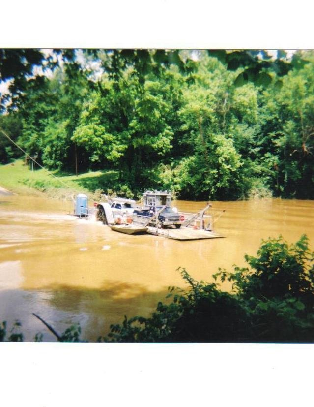 Redneck ingenuity, car ferry, flooded Green River, Mammoth Cave, KY. I like the outhouse!!! Adds a classy touch...