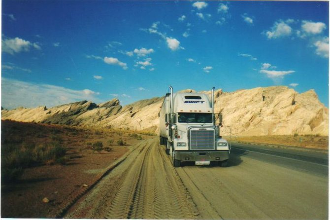 Freightshaker with San Rafael Reef in background, UT.