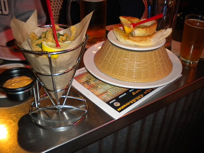 My $6 calamari in the cone holder; the $5 plate of mussels under the shell-discard basket.