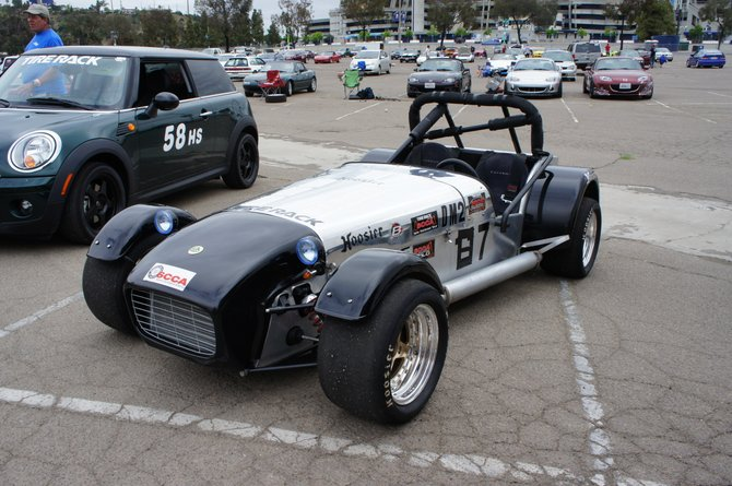 Caterham Super 7. Fast, fun, build-them-yourself cars. Tiny little revy 1.6 DOHC i4, I think this one might have had a Cosworth engine.