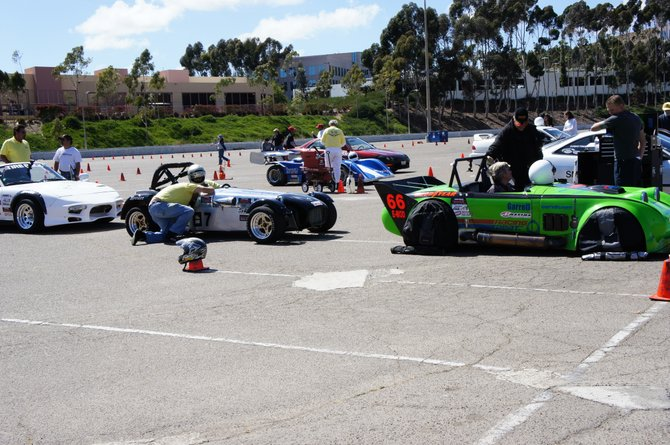 SCCA Solo event lining up on grid! Looks like we have a Caterham Super 7, a crazy tri-rotory Bug-eye sprite and a Miata out back.