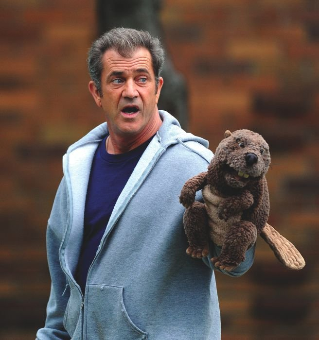 In The Beaver, Mel Gibson plays a toy executive falling into despair.