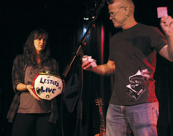Jimmie Lunsford picks names out of a jar for Lestat's open mic. 