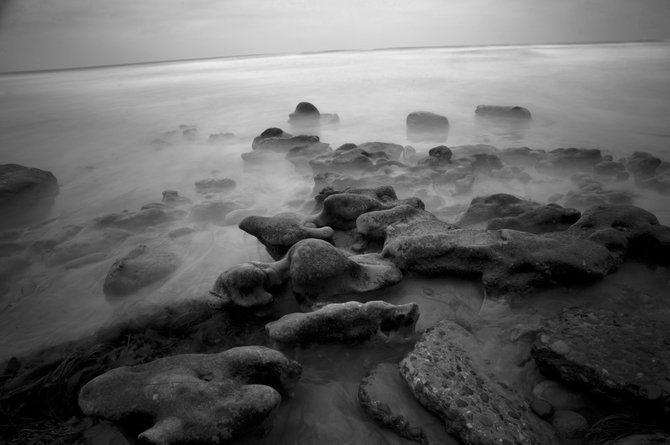 I took this long exposure underneath the cliffs at Terramar Beach in Carlsbad. I still got pretty wet, despite the low tide. This is thirty five second shot of the water, shot through my cheap neutral density filter, which is just a sheet of welding glass super glued to an old UV filter.