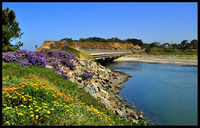 While exploring beautiful Del Mar, I captured this colorful photo off highway 101 at the river mouth.