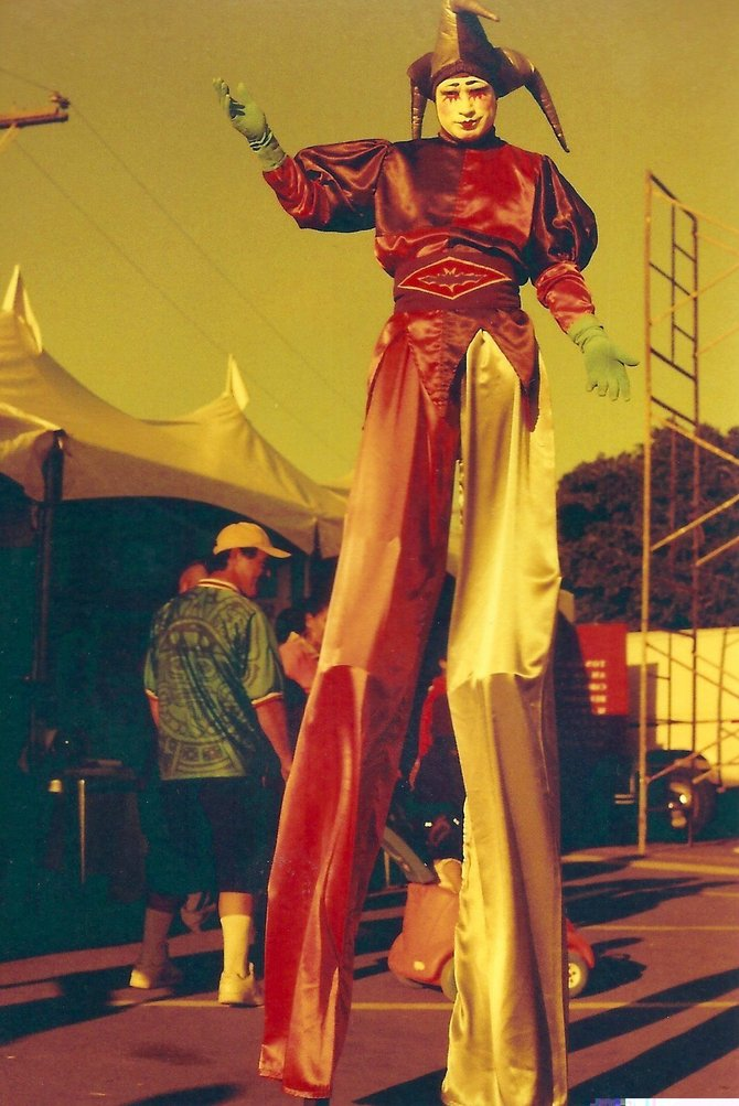 A man on stilts at an art show at Festiarte in Mexico.