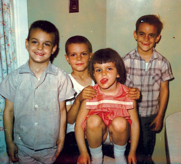 Mike Elliott, second from left, with three of his four siblings.