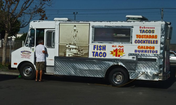"The Mariscos el Pescador truck is in the Toys ""R"" Us parking lot off I-5 at L Street."