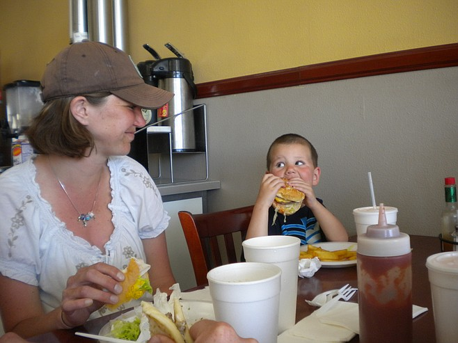 Three-year-old Kole from Denver, Colorado, looks to his mom, Beckie, for back-up in his attack on a quarter-pounder.