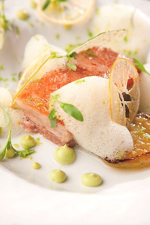 Confit pork belly, avocado purée, charred tomatillo with Meyer lemon chip and segments