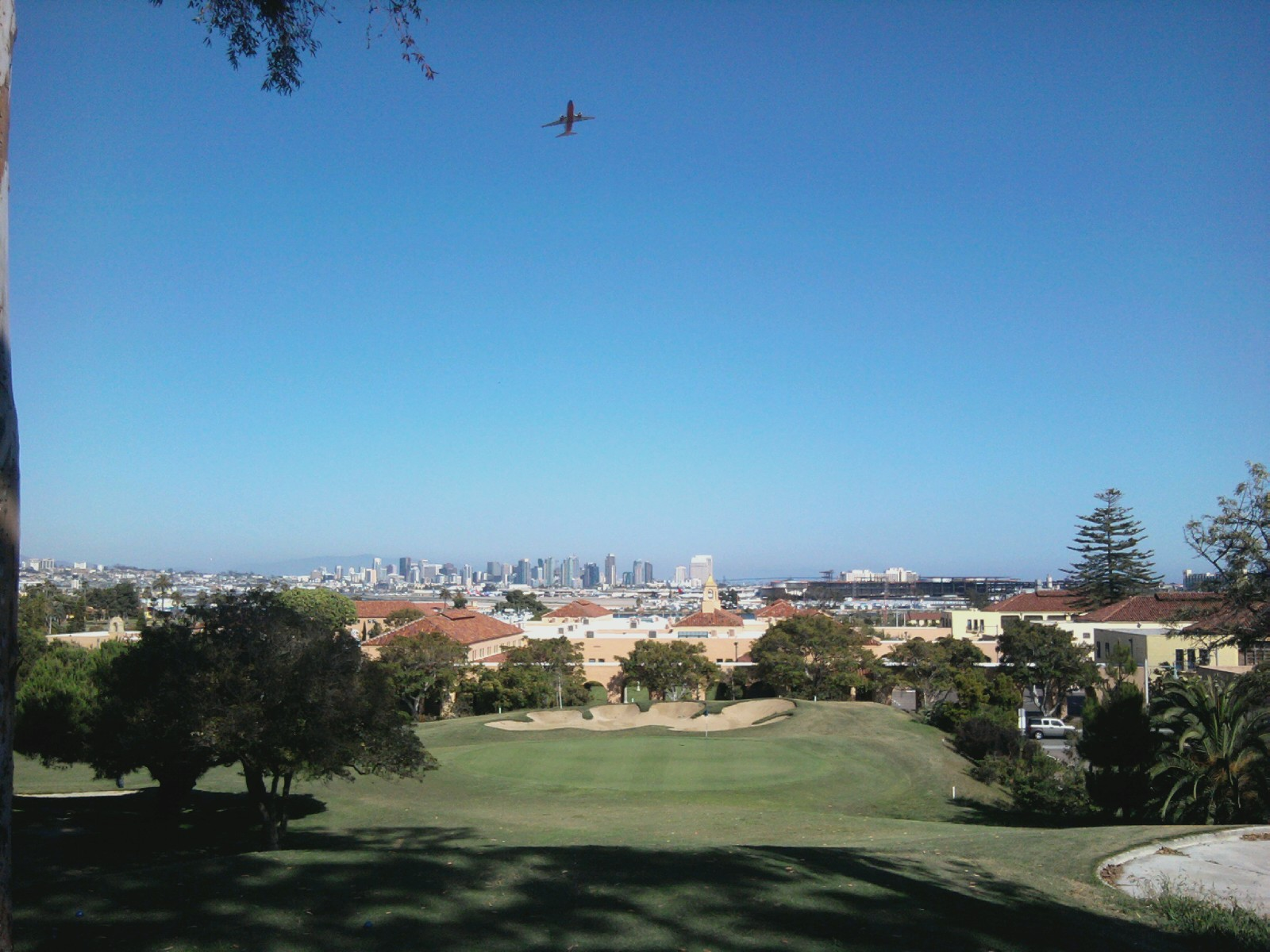 Golf picture, from sail-ho golf course. 5th hole overlooking downtown, with airplanes going by..