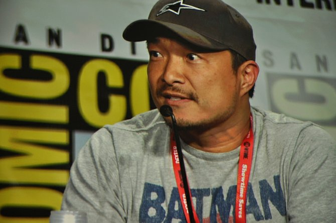 DC comics' Jim Lee designed the official 2011 Comic-Con souvenir book and T-shirt.