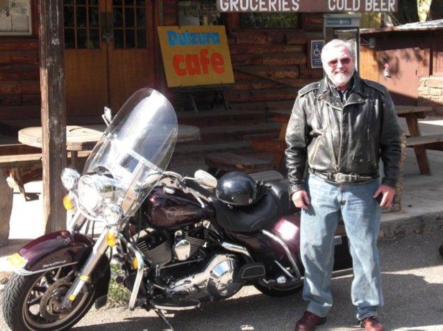 Dad beside his bike.