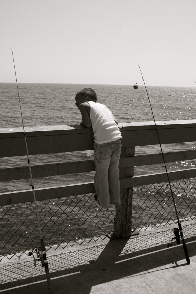 Hanging off the side of the ocean beach pier watching the locals fish!