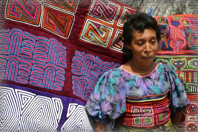 "Kuna saleswoman.  The Kuna Indian woman stand in front of the ""molas"" they sew and sell to tourists that visit the village.  I bought the two read ones to make into pillows."