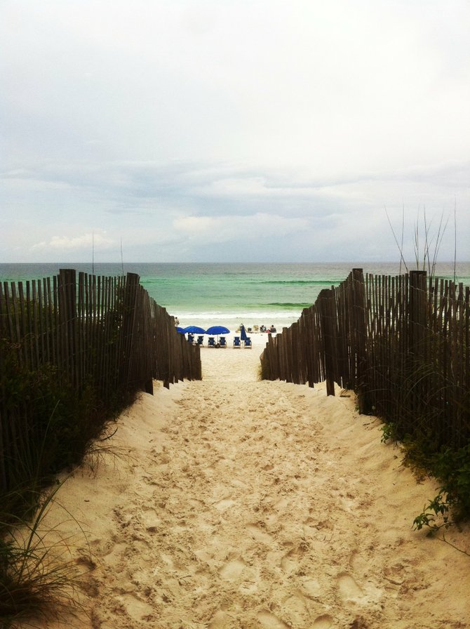 Walking to the white sand and clear water in Seaside, Florida.