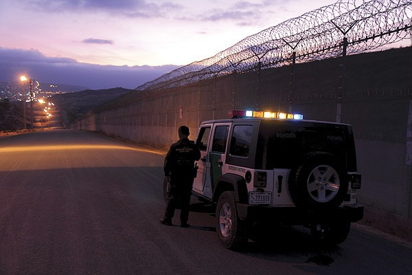 Early evening border patrol between the old and new fences at San Ysidro