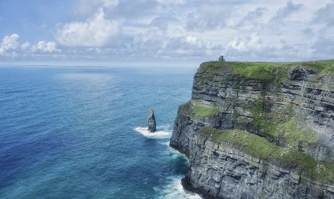 Taken in early July 2008. While traveling around Ireland, I made my way down to the south-western edge of the Burren to see the Cliffs of Moher. These cliffs are some of the most beautiful things I've seen in my life.