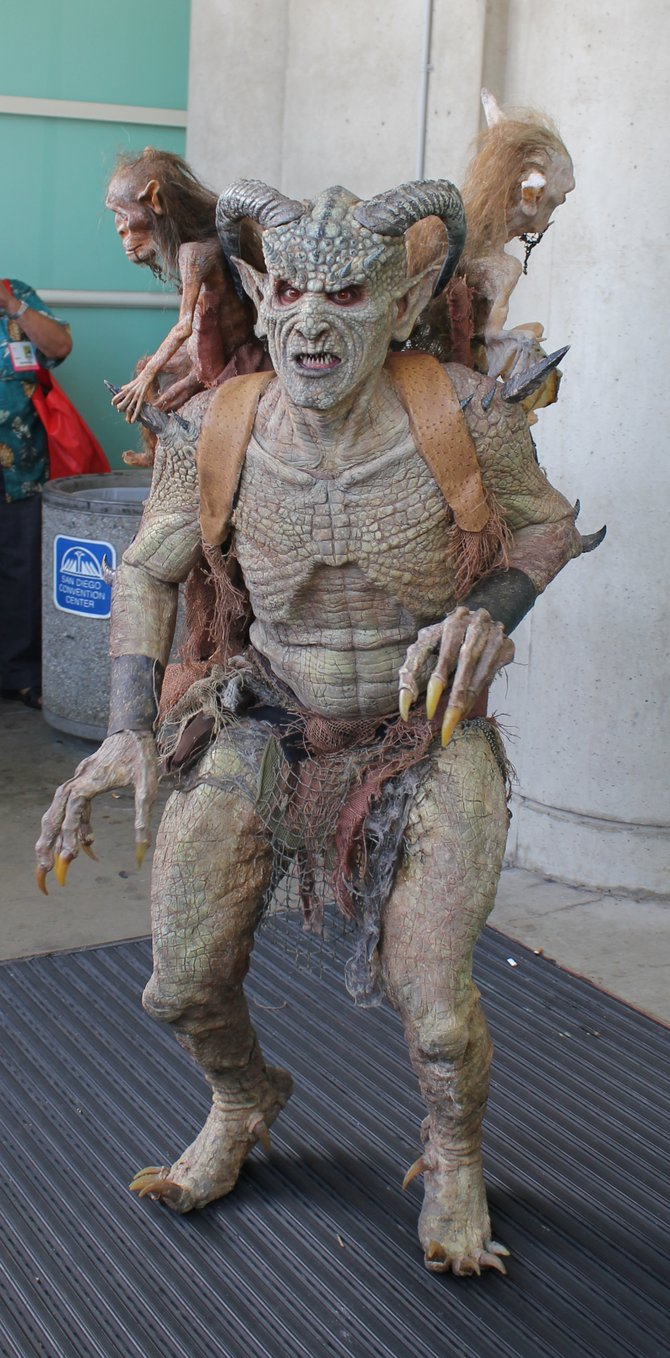 Monster alien creature which had two moving smaller creatures on his back, outside of Comic Con.