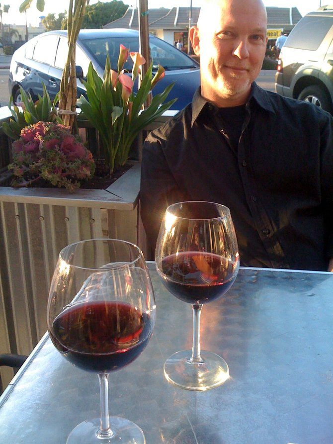 Sipping wine with my partner in crime.