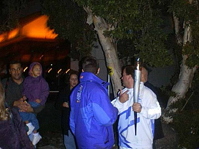 In 2002, I had gone down to Seaport Village to take some pictures of the Olympic torch as it toured San Diego en route to Salt Lake City.  I'm standing on the wall,  here comes the torch,  and some