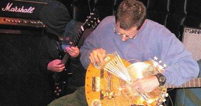 """Sound artist"" M.J. Stevens shredding his ""noise apparatus"""