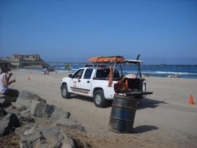 OB Lifeguard on beach patrol.