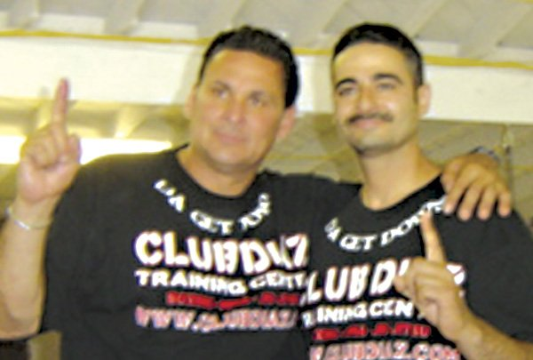 Convicted murderer Mark Diaz, on left, next to Ari Soltani, owner of the Vista boxing gym.