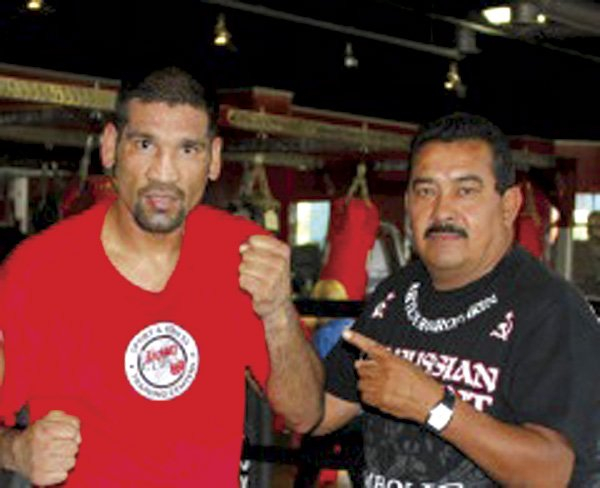 Pro fighter Danny Perez, on left, with his new trainer, soon-to-be murder victim Hector Gil.