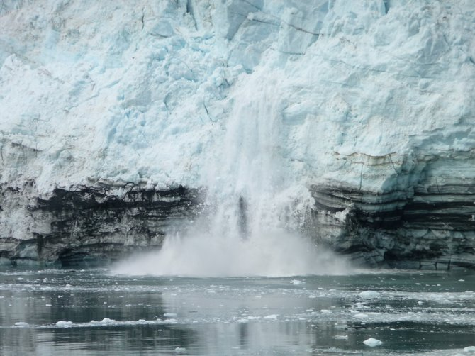 The ice calving of the active Margerie Glacier in Glacier Bay of southeast Alaska, June 2011, accompanied by the cracking thunder-like roaring sound in the midst of wilderness of tranquility.