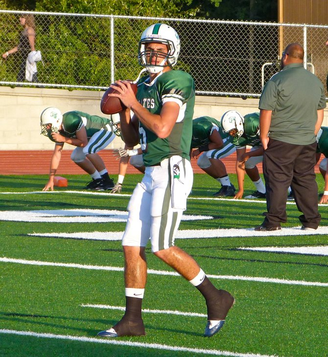 Oceanside quarterback Ryan Lamb throws during pregame warmups