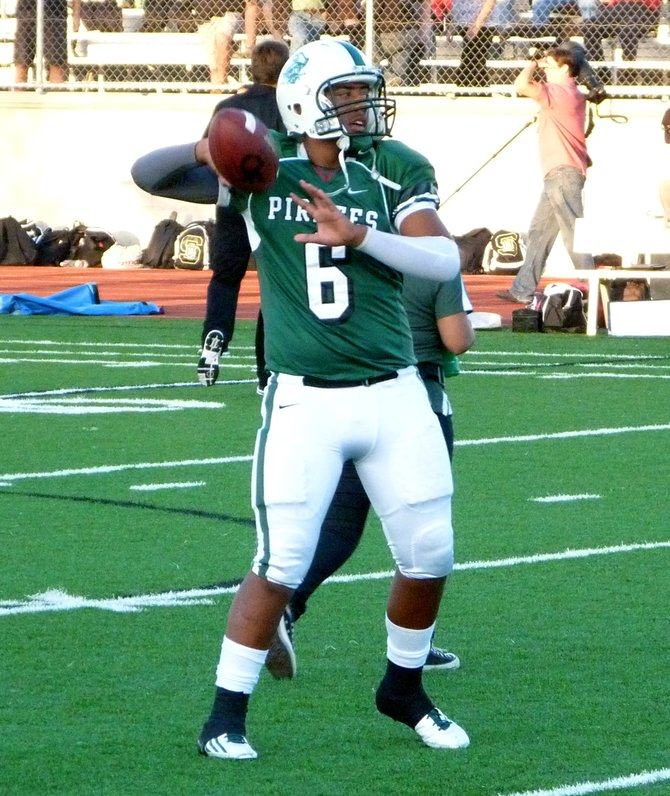 Oceanside quarterback Tofi Pao Pao throws a pass during warmups
