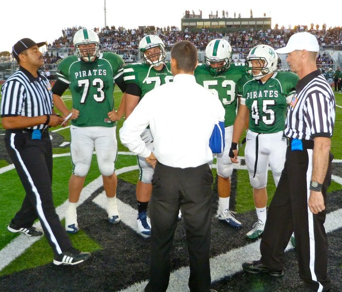 Oceanside's team captains at midfield for the coin toss