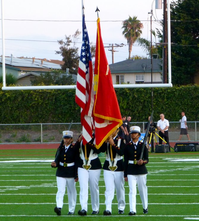 Oceanside's Marine Corps Jr. ROTC presents the colors for the National Anthem