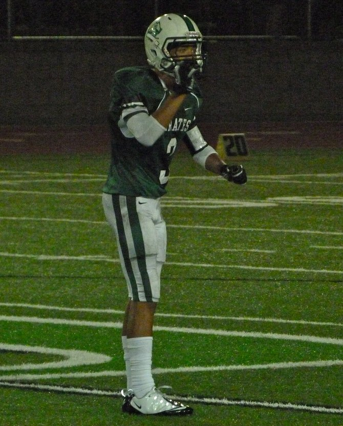 Oceanside defensive back Jace Whittaker motions to the Pirates sideline