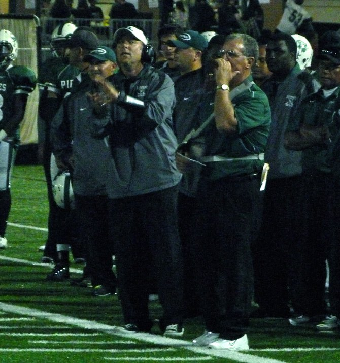 Oceanside defensive coordinator Patrick Coleman and head coach John Carroll give instructions to the Pirates defense