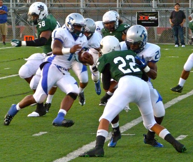 Eastlake running back Aaron Baltazar weaves through the Helix defense