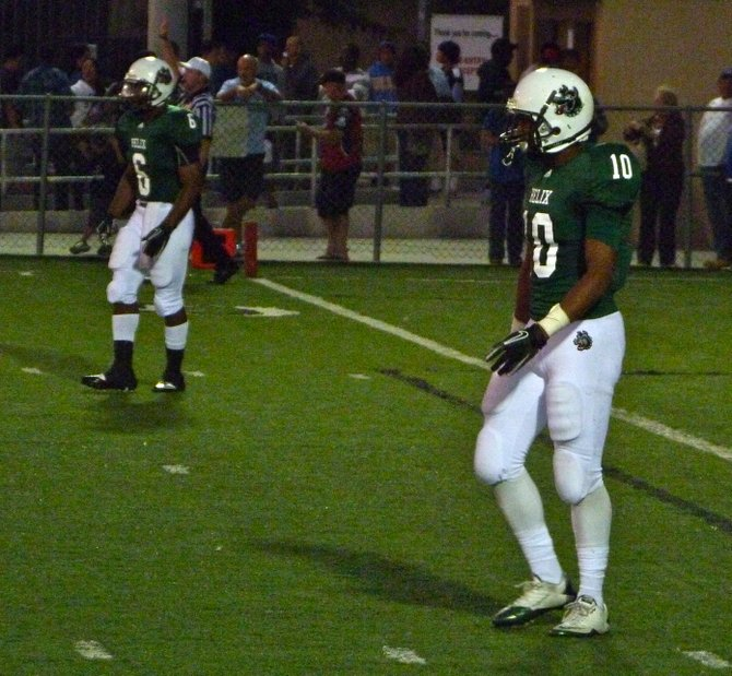 Helix receiver Marquise Powell (10) and running back Darrion Hancock (6) await a kickoff
