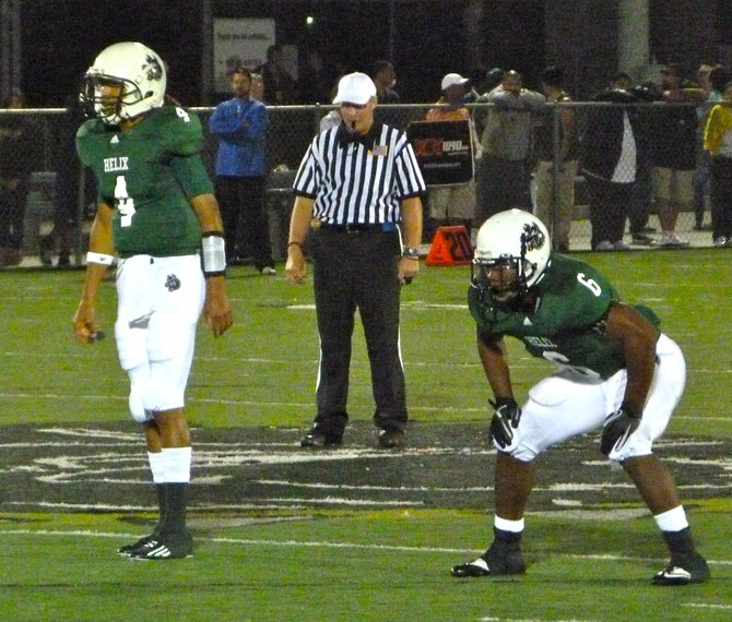 Helix quarterback Brandon Lewis (4) and running back Darrion Hancock (6) in the offensive backfield