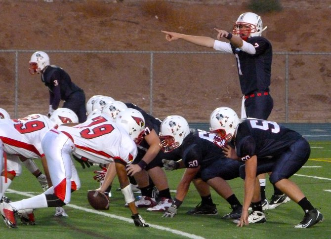 Christian quarterback Shane Dillon surveys the Hoover defense at the line of scrimmage