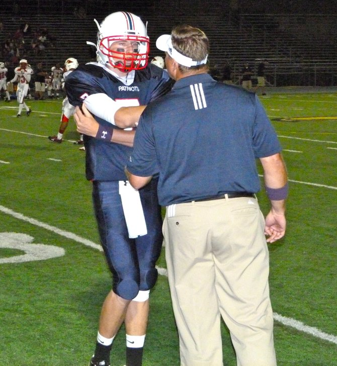 Christian quarterback Shane Dillon gets the play call from the Patriots' offensive coordinator